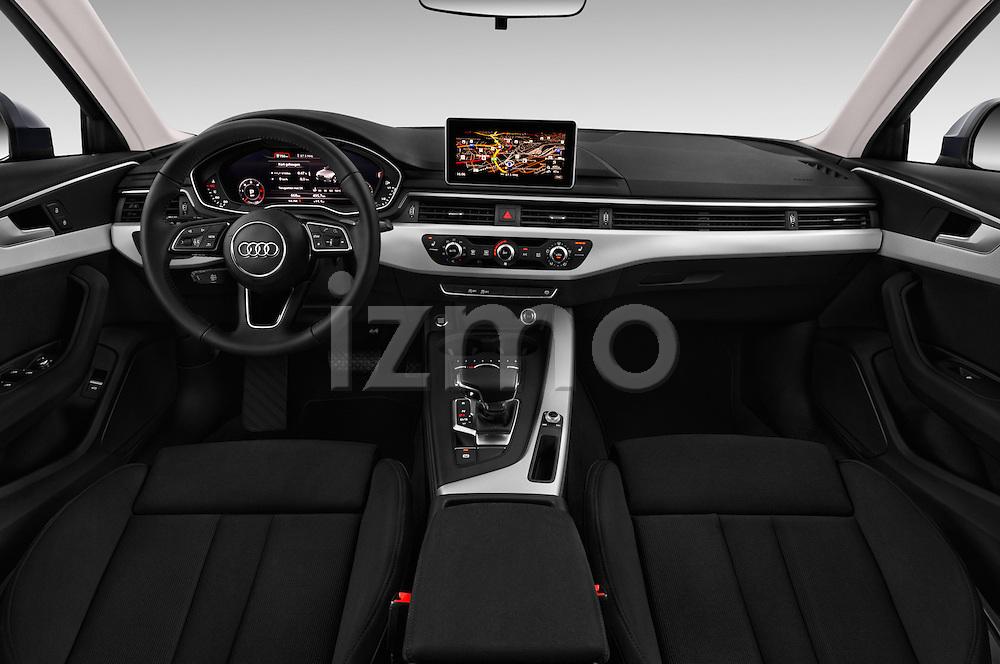 Stock photo of straight dashboard view of 2017 Audi A4 Sport 4 Door Sedan Dashboard