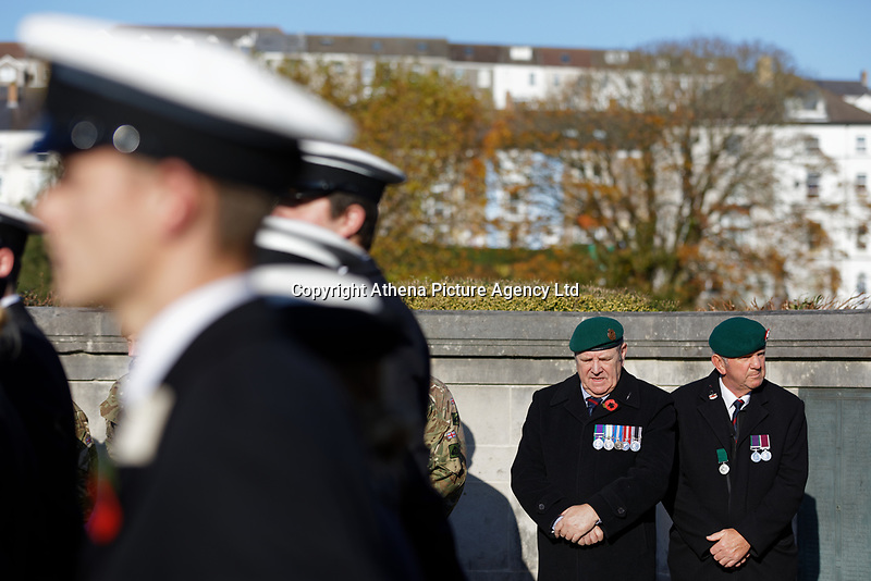 Pictured: Two veterans join members of the armed forces at the Cenotaph in Swansea, Wales, UK. Sunday 10 November 2019<br /> Re: Remembrance SUnday, a service to commemorate those who lost their lives in conflict has been held at the Cenotaph in Swansea, Wales, UK.