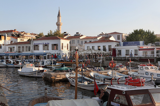 Old fishing port on the island of Bozcaada or Tenedos at the mouth of the Dardanelles Strait in the Aegean Sea, Canakkale, Turkey, with the minaret of the Alaybey mosque in the background. Picture by Manuel Cohen