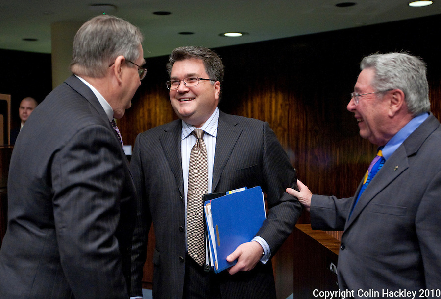 TALLAHASSEE, FLA. 3/2/10-OPENING DAY CH43-Sen. Rudy Garcia, R-Hialeah, center, is congratulated by Sen. Don Gaetz, R-Niceville, left, and Sen. Stephen Wise, R-Jacksonville, after the unemployment compensation tax deferment bill passed the Senate, Tuesday at the Capitol in Tallahassee. Gov. Charlie Crist signed it later in the day...COLIN HACKLEY PHOTO