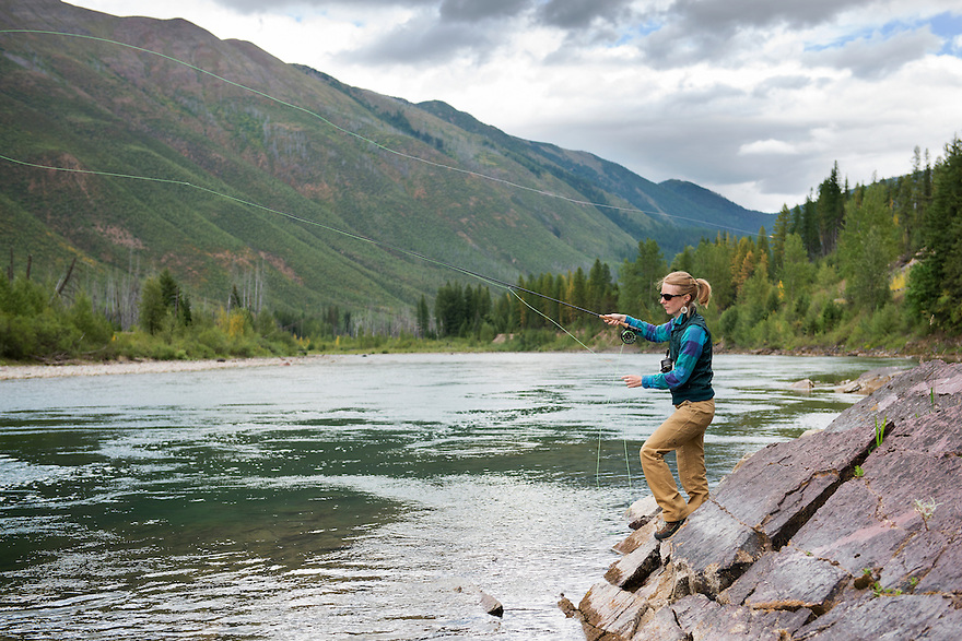 Christine Marozick, of Bozeman, Montana, casts for westslope cutthroat trout on the North Fork of the Flathead River east of Glacier National Park in northwest Montana.