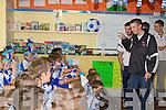 Crystal Swing Derek Burke who is Castleisland Desmonds Celebrity Banisteoir dancing and sings the Huckle Buck for the pupils of Castleisland Boys National school on Friday.