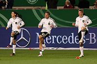 Mesut Oezil, Lukas Podolski, Bastian Schweinsteiger (D)