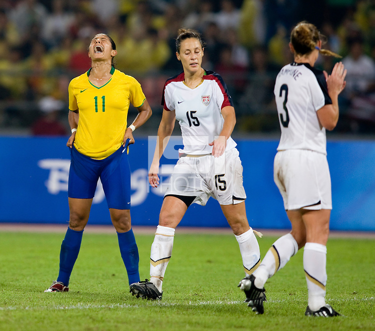 Brazilian forward (11) Cristiane shows her frustration after missing a shot while playing for the gold medal at Workers' Stadium.  The USWNT defeated Brazil, 1-0, during the 2008 Beijing Olympic final in Beijing, China.