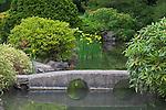 Seattle, WA<br /> Kubota Garden city park, a stone bridge spans a pond in the Japanese Garden