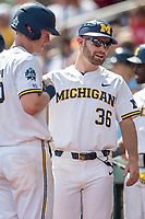 Michigan Wolverines assistant coach Michael Brdar (36) during Game 11 of the NCAA College World Series against the Texas Tech Red Raiders on June 21, 2019 at TD Ameritrade Park in Omaha, Nebraska. Michigan defeated Texas Tech 15-3 and is headed to the CWS Finals. (Andrew Woolley/Four Seam Images)