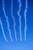 Aircraft flying in Close Formation in Sky with Smoke - at Abbotsford International Airshow, BC, British Columbia, Canada