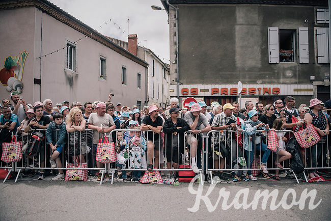 waiting for the riders to parade by in the start town of Saint-Girons<br /> <br /> 104th Tour de France 2017<br /> Stage 13 - Saint-Girons &rsaquo; Foix (100km)