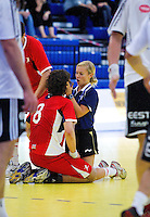 11 JUN 2010 - LONDON, GBR - British physiotherapist Lauren Bradshaw helps Martin Hare during the teams match against Estonia in their 2012 European Handball Championships Qualification Tournament (PHOTO (C) NIGEL FARROW)