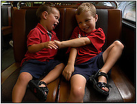 Two young brothers tickle one another while riding on a train into Pittsburgh, Pa. Model released image can be used for multiple purposes.
