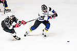 Verity Skater Lokel Wong (r) battle for the puck with Gaggia Empire Skater Terence Chim (l) during the Principal Standard League match between Gaggia Empire vs Verity at the Mega Ice on 10 January 2017 in Hong Kong, China. Photo by Marcio Rodrigo Machado / Power Sport Images