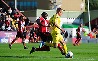 Fleetwood Town's Kyle Dempsey is tackled by Lincoln City's John Akinde<br /> <br /> Photographer Chris Vaughan/CameraSport<br /> <br /> The EFL Sky Bet League One - Lincoln City v Fleetwood Town - Saturday 31st August 2019 - Sincil Bank - Lincoln<br /> <br /> World Copyright © 2019 CameraSport. All rights reserved. 43 Linden Ave. Countesthorpe. Leicester. England. LE8 5PG - Tel: +44 (0) 116 277 4147 - admin@camerasport.com - www.camerasport.com