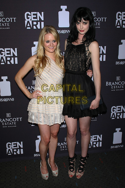 "Fallon Goodson & Krysten Ritter.The Special Gen Art screening of ""Life Happens"" at the SVA Theater, New York, NY, USA. .August 15th, 2011.full length white dress hand on hip silver stripe black lace sleeveless .CAP/LNC/TOM.©LNC/Capital Pictures."
