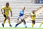 30 August 2013: Duke's Kaitlyn Kerr (center) sends the ball past Kennesaw State's Monica Herrera (9). The Duke University Blue Devils played the Kennesaw State University Owls at Fetzer Field in Chapel Hill, NC in a 2013 NCAA Division I Women's Soccer match. Duke won 1-0.