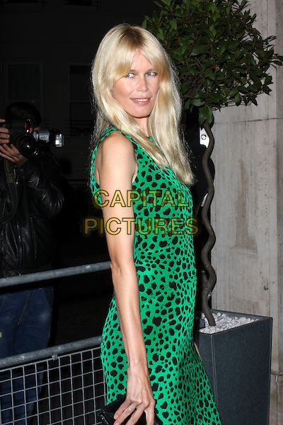 CLAUDIA SCHIFFER .The Vogue Dinner Party at La Caprice Restaurant, London, England..September 21st, 2009.half length black green sleeveless dress leopard print looking over shoulder .CAP/AH.©Adam Houghton/Capital Pictures.