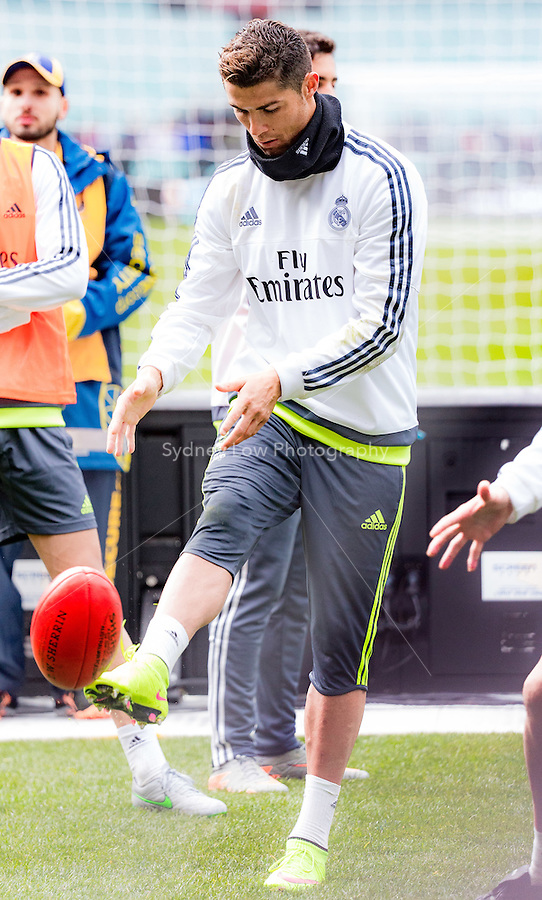 Melbourne, 17 July 2015 - Cristiano Ronaldo of Real Madrid kicks an Aussie Rules football after a training session at the Melbourne Cricket Ground ahead of their International Champions Cup match against AS Roma tomorrow in Melbourne, Australia. Photo Sydney Low/AsteriskImages.com