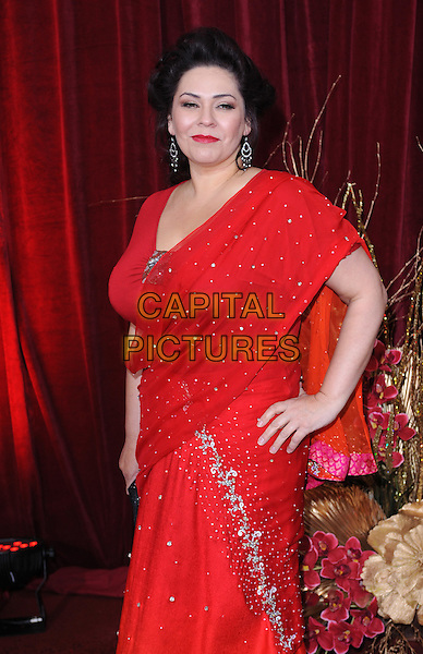 NICOLE BARBER LANE.Arrivals at the British Soap Awards 2010, London Television Centre, London, England..May 8th, 2010.half 3/4 length red dress sari beaded crystals sparkly hand on hip.CAP/BEL.©Tom Belcher/Capital Pictures.