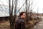 """Josh Barkan, 42, a writer in residence in Braddock, Pennsylvania, walks the streets of the city. Although the city lacks a hospital and grocery store, it has an artistic community thanks to efforts from the mayor. Barkan's residency is called """"Into the Furnace,"""" based on the famous book about steel called """"Out of the Furnace."""".""""I think here it was a rapid death and the population was cut in half over 10 years,"""" Barkan said of the mills closing and using less workers."""
