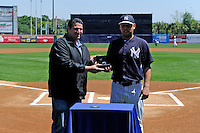 New York Yankees pitcher Vidal Nuno receives an award for top rookie before a Spring Training game against the Pittsburgh Pirates at Legends Field on March 28, 2013 in Tampa, Florida.  (Mike Janes/Four Seam Images)