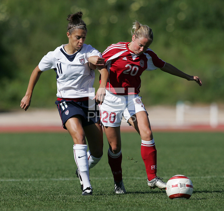 MAR 11, 2006: Quarteira, Portugal:  USWNT midfielder (11) Carli Lloyd tries to take the ball from Denmark midfielder (20) Janne Madsen in the Algarve Cup in Quarteira, Portugal.