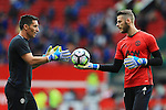 David De Gea of Manchester United warms up with goalkeeping coach Emilio Alvarez during the Premier League match at Old Trafford Stadium, Manchester. Picture date: September 24th, 2016. Pic Sportimage