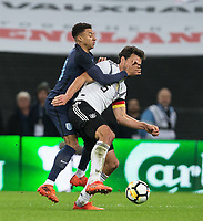 Jesse Lingard (Manchester United) of England gets to grips with Mats Hummels (Bayern Munich) of Germany during the International Friendly match between England and Germany at Wembley Stadium, London, England on 10 November 2017. Photo by Andy Rowland.