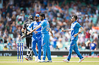 All smiles, Virat Kolli (India) congratulates Jasprit Bumrah (India) on the wicket of Munro during India vs New Zealand, ICC World Cup Warm-Up Match Cricket at the Kia Oval on 25th May 2019