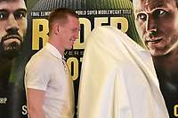 Ted Cheeseman poses with a white sheet 'The Ghost' (in the absence of boxer Asinia Byfield) during a Press Conference at the Courthouse Hotel on 13th September 2018