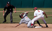 STANFORD, CA - April 17, 2011: Kenny Diekroeger of Stanford baseball applies the tag for the out on a stolen base attempt during Stanford's game against Oregon State at Sunken Diamond. Stanford lost 6-4.