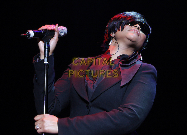 GABRIELLE.Performing live in concert at Hammersmith Apollo, London, England, November 6th 2008..half length sunglasses microphone black top shirt diamante music gig  on stage.CAP/MAR.©Martin Harris/Capital Pictures