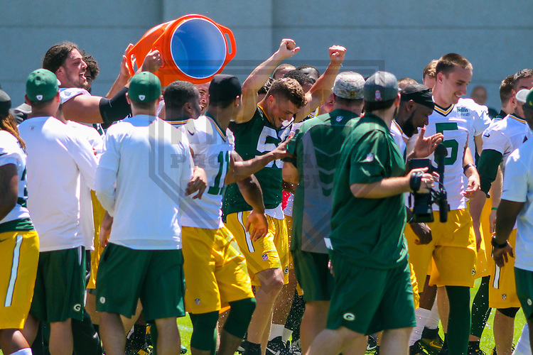 Green Bay Packers linebacker Jordan Tripp (58) gets a Gatorade shower from teammates following the team's final minicamp practice on June 15, 2017 at Clarke Hinkle Field in Green Bay, Wisconsin.  (Brad Krause/Krause Sports Photography)