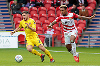 Fleetwood Town's Lewis Coyle gets away from Doncaster Rovers' Mallik Wilks<br /> <br /> Photographer David Shipman/CameraSport<br /> <br /> The EFL Sky Bet League One - Doncaster Rovers v Fleetwood Town - Saturday 6th October 2018 - Keepmoat Stadium - Doncaster<br /> <br /> World Copyright &copy; 2018 CameraSport. All rights reserved. 43 Linden Ave. Countesthorpe. Leicester. England. LE8 5PG - Tel: +44 (0) 116 277 4147 - admin@camerasport.com - www.camerasport.com