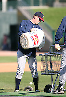 2007:  Zach Miner of the Toledo Mudhens empties the bucket during batting practice prior to a game vs. the Rochester Red Wings in International League baseball action.  Photo By Mike Janes/Four Seam Images