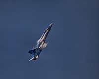 "A CF-18 Hornet goes for the vertical in ""The True North Strong and Free"" colour scheme at the Canadian International Air Show."
