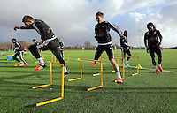 Pictured L-R: Angel Rangel, Jack Cork and Bafetimbi Gomis Wednesday 23 December 2015<br />Re: Swansea City FC training ahead of their West Bromwich Albion game, Fairwood, near Swansea, Wales, UK