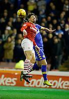 Barnsley v Leeds..EFL Championship 21.1.17 ....  barnsleys tom bradshaw heads with  leeds kemar roofe