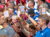Fans hold up signs as the National Anthem is played prior to the game pitting Indianapolis Colts against the Washington Redskins at FedEx Field in Landover, Maryland on Sunday, September 16, 2018.<br /> Credit: Ron Sachs / CNP
