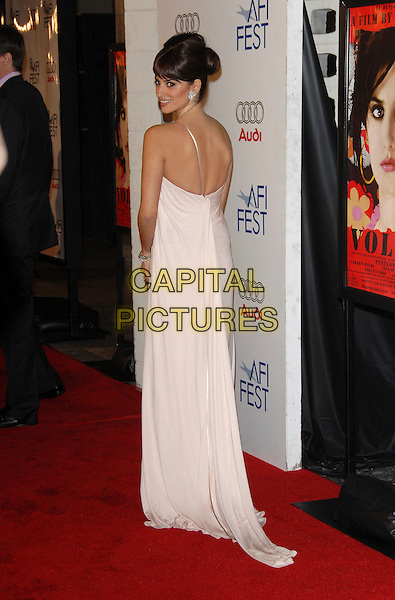 "PENELOPE CRUZ.The AFI Festival Screening of ""Volver"" held at The Arclight Theatre in Hollywood, California, USA. .November 2nd, 2006.Ref: DVS.full length one shoulder pink dress looking over shoulder  cream white.www.capitalpictures.com.sales@capitalpictures.com.©Debbie VanStory/Capital Pictures"