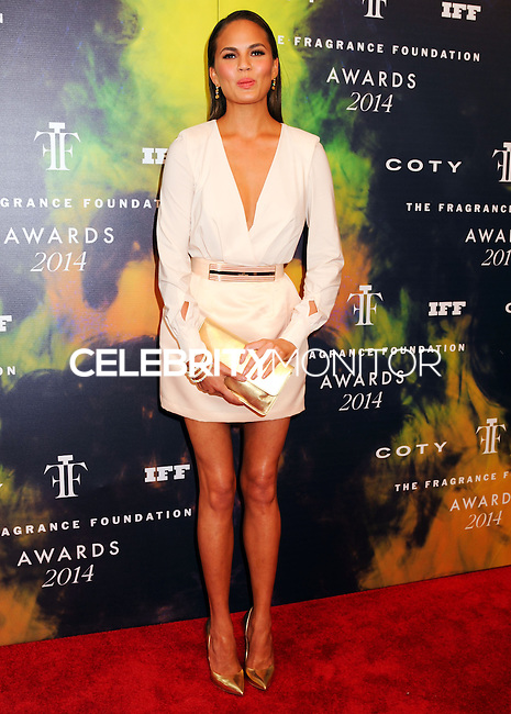 NEW YORK CITY, NY, USA - JUNE 16: Chrissy Teigen arrives at the 2014 Fragrance Foundation Awards held at the Alice Tully Hall, Lincoln Center on June 16, 2014 in New York City, New York, United States. (Photo by Celebrity Monitor)