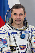 This file photo of Russian cosmonaut Mikhail Kornienko, attired in a Russian Sokol launch and entry suit, was taken in Star City, Russia in March, 2010 prior to his earlier mission aboard the ISS.  Kornienko, and Scott Kelly, have been selected by the Russian Federal Space Agency (Roscosmos), NASA, and their international partners for a one-year mission aboard the International Space Station in 2015. This mission will include collecting scientific data important  to future human exploration of our solar system.  Kornienko is from the Syzran, Kuibyshev region of Russia. He is a former paratrooper officer and graduated from the Moscow Aviation Institute as a specialist in airborne systems. He has worked in the space industry since 1986 when he worked at Rocket and Space Corporation-Energia as a spacewalk handbook specialist. He was selected as an Energia test cosmonaut candidate in 1998 and trained as an International Space Station Expedition 8 backup crew member. Kornienko served as a flight engineer on the station's Expedition 23/24 crews in 2010 and has logged more than 176 days in space. .Credit: Roscosmos/Gagarin Cosmonaut Training Center via CNP