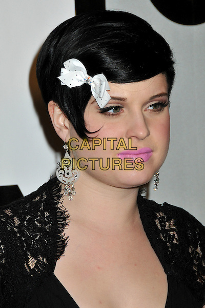 KELLY OSBOURNE.FOX All-Star Winter 2009 TCA Party at My House Night Club, Hollywood, California, USA..January 13th, 2009.headshot portrait black lace white dangling earrings ribbon bow in hair pink lipstick .CAP/ADM/BP.©Byron Purvis/AdMedia/Capital Pictures.
