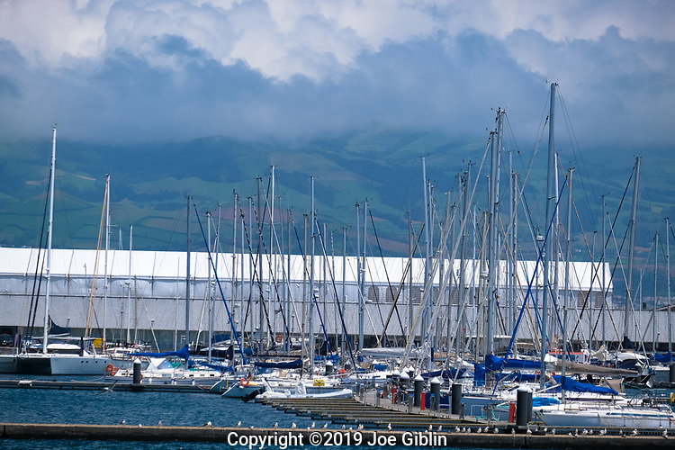 Looking across the Ponta Delgada harbor at the mountains of Sao Miguel, Portugal, the largest island in the Azores.