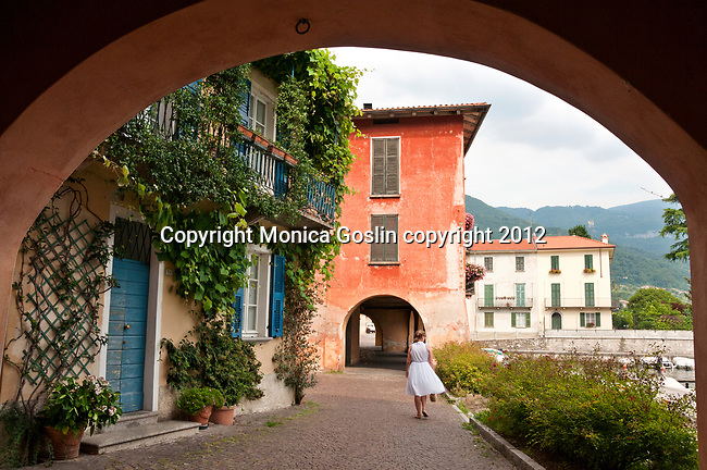 Colorful houses and waterfront in Mandello del Lario, a town on Lake Como