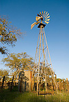 Shot-up, rusting Aermotor windmill in the rural Sierra Nevada Foothills of California.