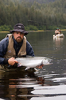 Kayak fishing for Silver salmon (Coho) in the Valdez, Alaska area of south central Alaska with Pacific Mountain Guides outfitter Otto Kulm. Fishing was done in both salt water and fresh water in the Prince William Sound region. Otto Kulm with a nice salt water fly caught Coho.