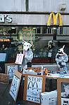 Protesters set up a stall in Cornmarket, Oxford on a  busy shopping day to protest against the unhealthy  food and mass consumerism that McDonalds encourage.  They handed out veggie nuggets and pamphletted passers by.