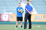 24 August 2013: Minnesota assistant coach Carl Craig (ENG) (left) talks with Carolina head coach Colin Clarke (NIR) (right). The Carolina RailHawks played the Minnesota United FC Loons at WakeMed Stadium in Cary, NC in a 2013 North American Soccer League Fall Season game. Carolina won 1-0.