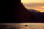 Alaska, Yukon River, Yukon Charley National Preserve, National Park ranger moving upstream between the towns of Eagle and Circle, sunset,.