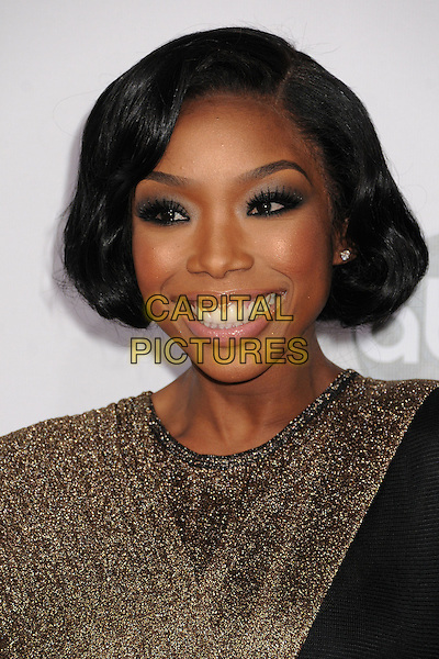 Brandy Norwood.40th Anniversary American Music Awards - Arrivals held at Nokia Theatre L.A. Live, Los Angeles, California, USA.  .November 18th, 2012.headshot portrait smiling black gold sparkly  .CAP/ADM/BP.©Byron Purvis/AdMedia/Capital Pictures.