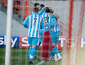 ::  STEPHEN ELLIOT IS CONGRATULATED AFTER SCORING THE FIRST  ::